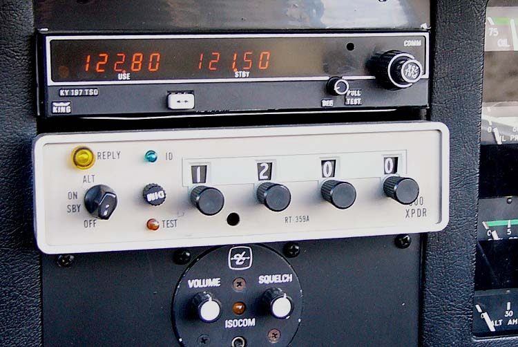 Cessna ARC RT-359A transponder (beige box), beneath a VHF radio. Source: Wikipedia