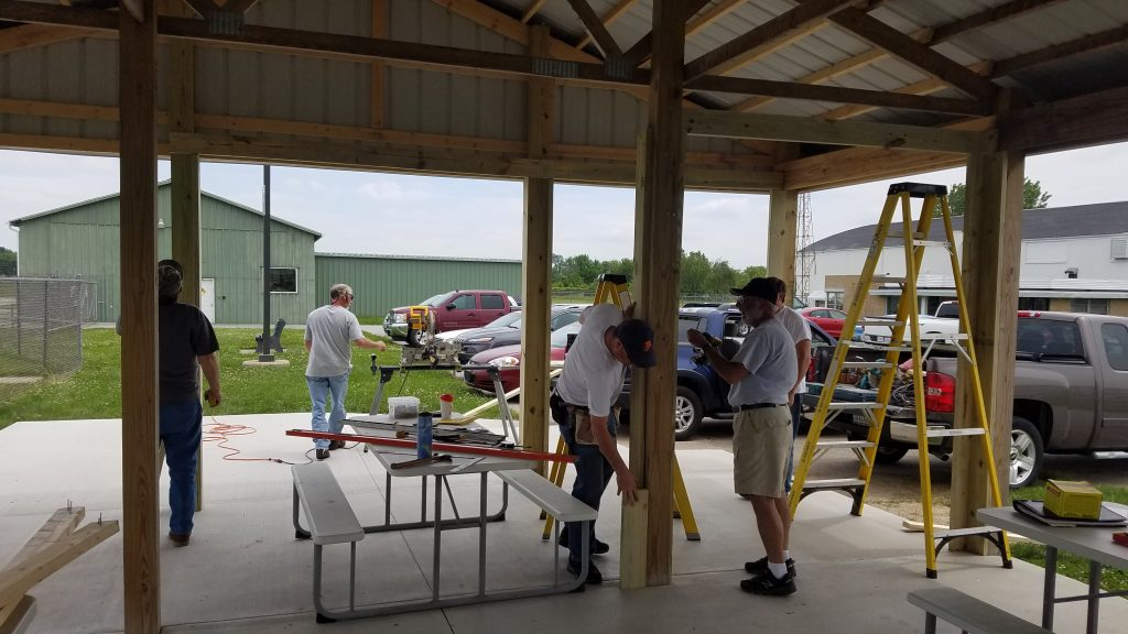 EAA Chapter 104 at work framing some doors at the Aviation Pavilion at KVPZ.