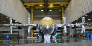 Fat Albert getting it's paint stripped. Air Force photo by Kelly White.